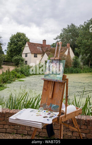 Artists painting Willy Lott's house at the National Trust's Flatford Mill made famous by the artist John Constable 1776 -1837,  Suffolk, England, UK - Stock Photo