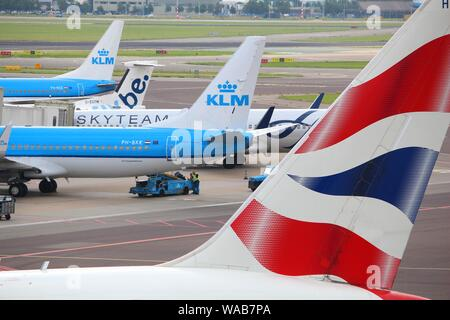 AMSTERDAM, NETHERLANDS - JULY 11, 2017: Airlines at Schiphol Airport in Amsterdam. Schiphol is the 12th busiest airport in the world with more than 63 - Stock Photo