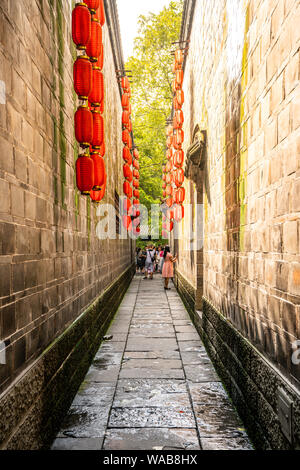 Narrow alley with red Chinese lanterns at Jinli ancient town in Chengdu Sichuan China - Stock Photo