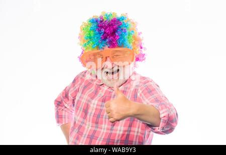 Nice joke. Grandpa always fun. Man senior bearded cheerful person wear colorful wig and sunglasses. Elderly clown. Having fun. Funny lifestyle. Fun and entertainment. Comic grandfather concept. - Stock Photo