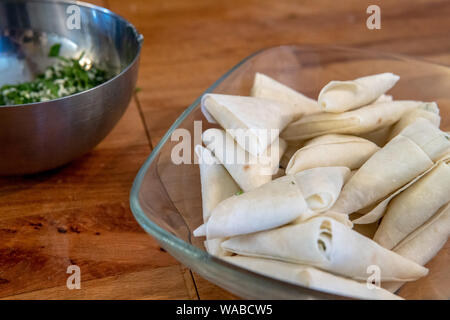 Phyllo dough stuffed with cheese and green herbs - Stock Photo