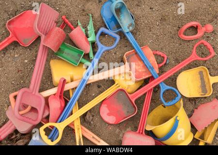 Dresden, Germany. 19th Aug, 2019. Shovels and buckets lie on a playground in a sandbox. Credit: Sebastian Kahnert/dpa-Zentralbild/dpa/Alamy Live News - Stock Photo