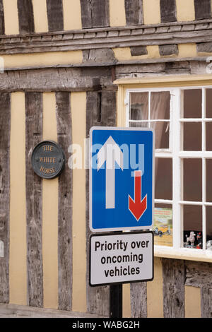 The picturesque medieval village of Lavenham with unsightly street signs, Suffolk, England, UK - Stock Photo