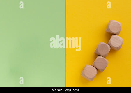 Kids toys on pastel yellow green paper background. Top view on children's educational games. Wooden cubes. Flat lay, copy space - Stock Photo