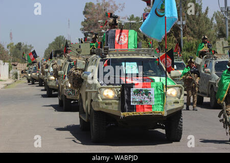 Lashkar Gah, Afghanistan. 19th Aug, 2019. A military convoy is seen during the celebration of Afghan Independence Day in Lashkar Gah, capital of Helmand province, southern Afghanistan, Aug. 19, 2019. Credit: Abdul Aziz Safdari/Xinhua Credit: Xinhua/Alamy Live News - Stock Photo