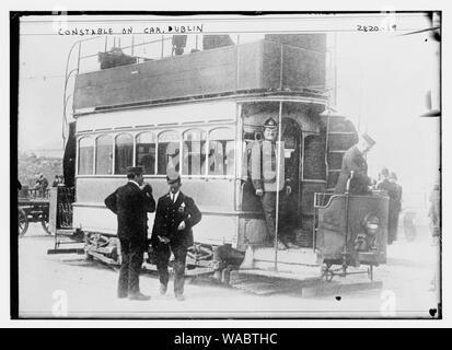 Constable on car - Dublin - Stock Photo
