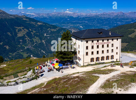 Weisshorn Hotel above the valley Val d'Anniviers, Saint-Luc, Valais, Switzerland - Stock Photo