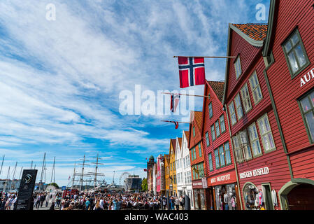 Celebrations for Norway's Constitution day (aka National day & 17 May), on Bryggen, one of Bergen's main attractions and UNESCO's world Heritage list. - Stock Photo