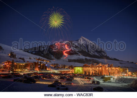 A torch light parade and fireworks bring 2015 to a colorful end at Crested Butte Mountain Resort in Mount Crested Butte, Colorado. - Stock Photo
