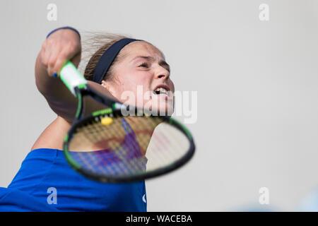 Aegon International 2016, Eastbourne, England -  Jelena Ostapenko of Latvia serving against Daria Kasatkina of Russia. Sunday, 19, June, 2016. Photo C - Stock Photo