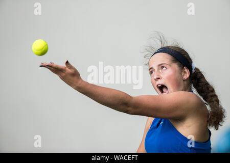 Jelena Ostapenko of Latvia serving against Daria Kasatkina of Russia at Aegon International 2016, Eastbourne, England - Sunday, 19, June, 2016. Photo - Stock Photo