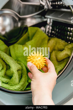 Using pvc dryer balls is natural alternative to both dryer sheets and liquid fabric softener, balls help prevent laundry from clumping in the dryer. - Stock Photo