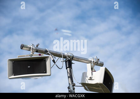 A sound amplifying speaker at airshow with flying  display in background (EDITORIAL USE ONLY) - Stock Photo