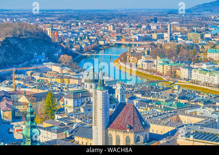 The view on Altstadt district of Salzburg with bell towers of medieval churches and winding Salzach river on the background, Austria