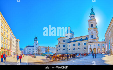 SALZBURG, AUSTRIA - FEBRUARY 27, 2019: The ensemble of Residenzplatz edifices with splendid Cathedral and Residence Palace on the background, on Febru - Stock Photo