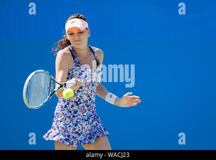 Aegon International 2016, Eastbourne, England -  Agnieszka Radwanska of Poland playing single handed forehand against Dominika Cibulkova of Slovakia. - Stock Photo