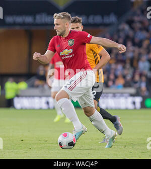 19th August 2019; Molineux Stadium, Wolverhampton, West Midlands, England; English Premier League, Wolverhampton Wanderers versus Manchester United; Luke Shaw of Manchester United on the attack with the ball at his feet - Strictly Editorial Use Only. No use with unauthorized audio, video, data, fixture lists, club/league logos or 'live' services. Online in-match use limited to 120 images, no video emulation. No use in betting, games or single club/league/player publications - Stock Photo
