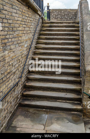 Millworkers steps outside Salts Mill in Saltaire, Yorkshire.The steps lead from the outside of the mill up to the pavement. - Stock Photo