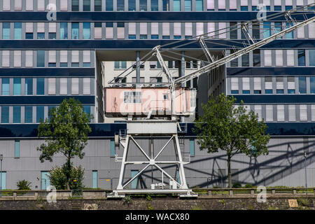 Duisburg, inner harbour, old harbour crane in front of modern office building, - Stock Photo