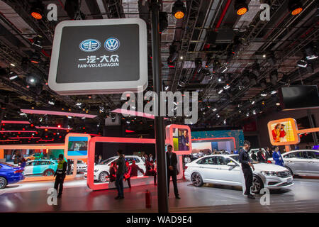 --FILE--People visit the stand of Volkswagen Group during the 18th Shanghai International Automobile Industry Exhibition, also known as Auto Shanghai - Stock Photo
