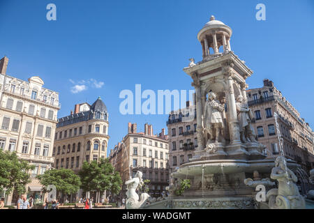 LYON, FRANCE - JULY 13, 2019: Place des Jacobins Square in Lyon with its iconic fountain. It is one of the main landmarks of the Old Lyon in the Presq - Stock Photo