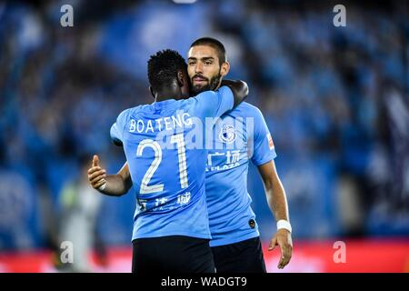 Ghanaian football player Emmanuel Okyere Boateng, left,  of Dalian Yifang celebrates with Belgian football player Yannick Ferreira Carrasco after scor - Stock Photo