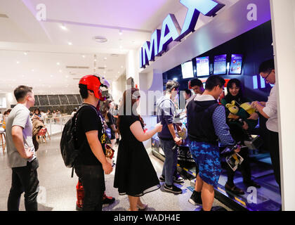 --FILE--Chinese filmgoers wait inside a cinema featuring IMAX before the midnight premiere of Disney and Marvel's 'Avengers: Endgame' in Shanghai, Chi - Stock Photo
