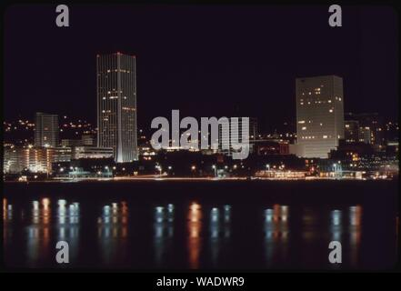 Downtown-core-area-of-portland-after-7-pm-on-november-2-1973-during-the-states-energy-crisis-with-few-commercial-and-neon-lighting-displays-this-photo-looks-toward-the-west-with-the-willamette-river-in-the-foreground- - Stock Photo