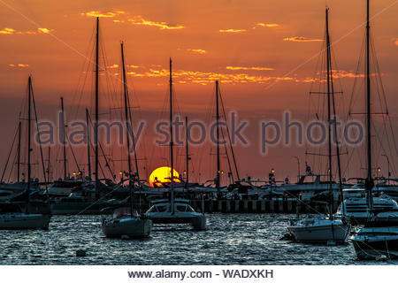 Sunset, boats and a beautiful view of Punta Del Este Uruguay. - Stock Photo