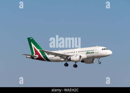 Munich, Germany - March 31. 2019 : Alitalia Airbus A319-112 with the aircraft registration EI-IMD in the approach to the southern runway 08R of the Mu - Stock Photo