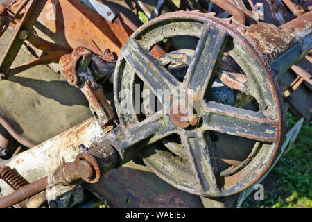 Rusty  retro vintage  small  tractor  gears and wheels background. The metal equipment is made more than hundred years ago. Mass production. - Stock Photo
