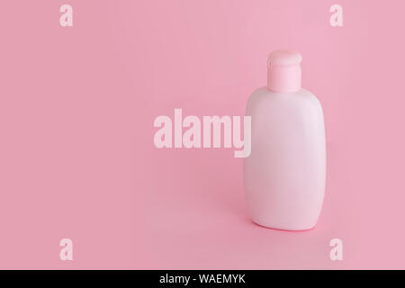 Organic natural cosmetic for baby, pink plastic bottle of bath cream, shampoo, lotion on pink background. Mockup, copy space. - Stock Photo
