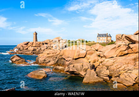 Landscape on the Pink Granite Coast in Perros-Guirec, northern Brittany, with the Ploumanac'h lighthouse, named Mean Ruz and made of pink granite. - Stock Photo
