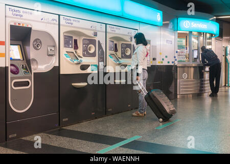 Paris metro ticket machine - a woman buying tickets for the metro in Paris, France, Europe. - Stock Photo