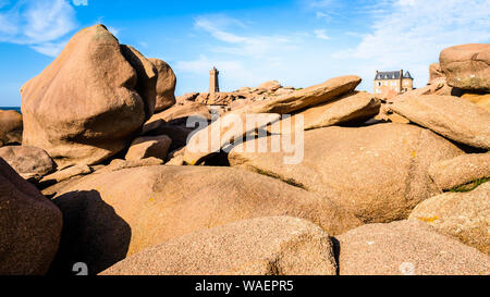 Panoramic view of the Pink Granite Coast in Perros-Guirec, northern Brittany, with the Ploumanac'h lighthouse, named Mean Ruz and made of pink granite - Stock Photo