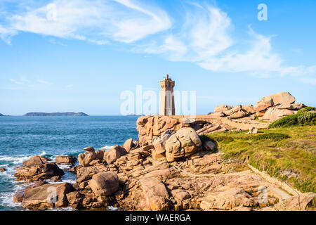 The Ploumanac'h lighthouse, named Mean Ruz, on the Pink Granite Coast in Perros-Guirec, northern Brittany, France. - Stock Photo