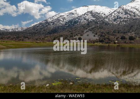 Omalos pond, a Mediterranean Temporary Pond on the Omalos plateau, White mountains, Crete. - Stock Photo