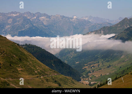 Looking towards the town of Luz  with low cloud in the valley from the road to the Col du Tourmalet Pyrenees National Park France July 2015 - Stock Photo