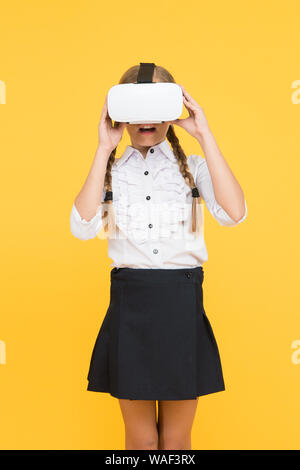 Modern technologies. Small child wear wireless VR glasses. Happy kid use modern technology. future education. back to school. Digital future and innovation. virtual reality. Little girl in VR headset.