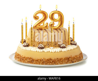 Festive cake with golden candles - Number 29 - Stock Photo