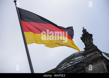 Berlin, Germany. 16th Aug, 2019. A Germany flag at the Reichstag Building or the German Federal Parliament Building in Berlin. Credit: Omar Marques/SOPA Images/ZUMA Wire/Alamy Live News - Stock Photo