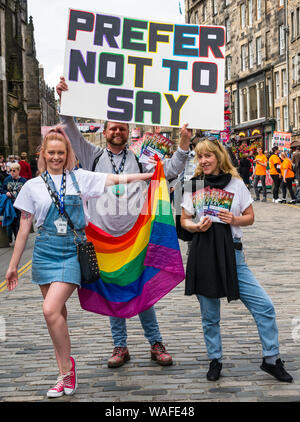 Edinburgh, Scotland, UK, 20 August 2019. Edinburgh Festival Fringe: Performers on the Royal Mile try to attract people to their shows. Performers from a show called Prefer Not to Say, a play that exposes through real life testimonies, the inequality and prejudice towards the LGBTQ+ community - Stock Photo