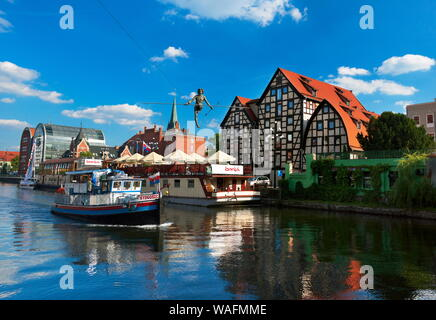 Bydgoszcz, Northern Poland, view from the Brda river cinty centre; relic granaries, 'Passing the River' figure hanging above the Brda river. Installed on May 1st 2004, the day Poland accessed the EU. Bydgoszcz in Kuyavia (Kujawy) region phot. Jan Wlodarczyk/FORUM - Stock Photo