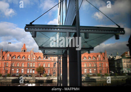 Bydgoszcz, Northern Poland, neo-gothic post office building view from Brda river, the Old Town, reflection in a modern glass building. 2006.11.10 phot. Jerzy Pawleta/FORUM - Stock Photo