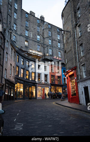 Streetview of Victoria Street with its cobbled road gentle curve and colourful shopfronts Old Town Edinburgh Scotland