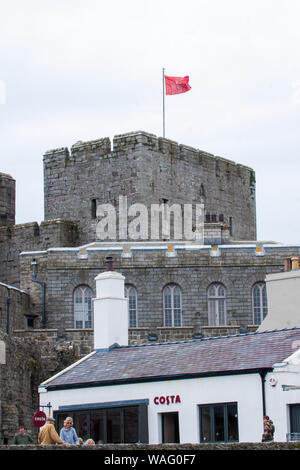 Even trendy coffee shops must find a traditional building in Castletown, Isle of Man - Stock Photo