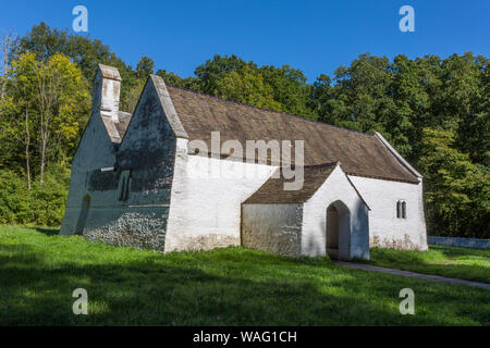 The pastoral setting of the c1520 St Teilo's church, Llandeilo at St Fagans National Museum of Welsh History, Cardiff, Wales, UK