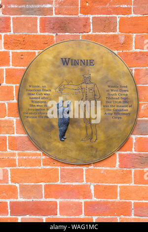 Winnie plaque on wall of Tilshead Village Hall at Tilshead, near Salisbury, Wiltshire UK in August - Stock Photo