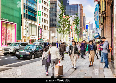 7 April 2019: Tokyo, Japan - Shopping in the Ginza District, considered one of the most expensive and luxurious shopping areas in world. - Stock Photo