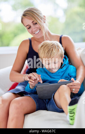 Mother sat interacting with her son - Stock Photo